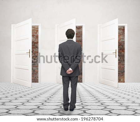 Young businessman standing in front of the bricked-up doors