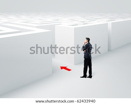 young businessman standing infront of 3d maze