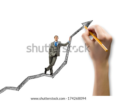 Young businessman standing on drawn graph arrow - stock photo