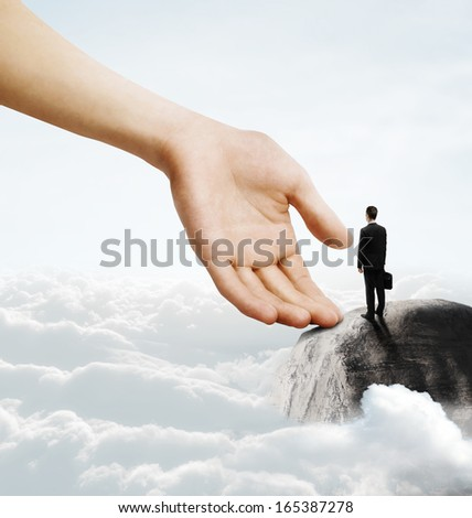young businessman standing on mountain - stock photo