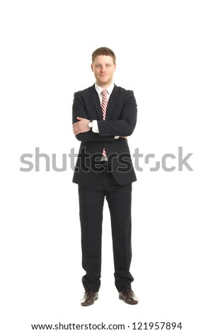 Young Businessman standing with arms crossed. Isolated on white background.
