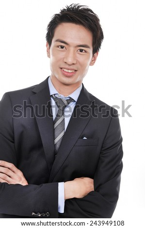 young businessman stands with arms folded - stock photo