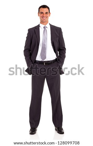 young businessman studio portrait both hands in pockets - stock photo