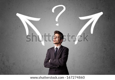 Young businessman taking a decision with arrows and question mark above his head - stock photo