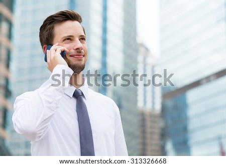 Young Businessman talk to cellphone - stock photo