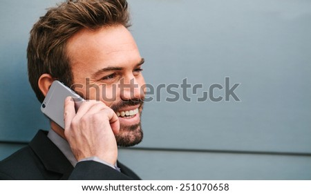 Young Businessman Talking by Phone in the Street - stock photo