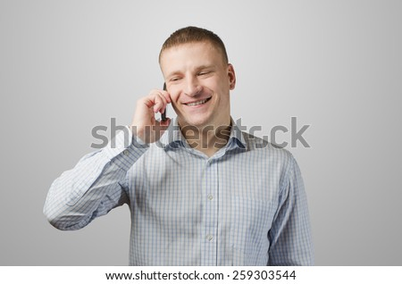Young businessman talking on a cell phone. Isolated on white background