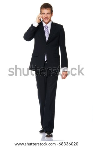 Young businessman talking on mobile phone - stock photo