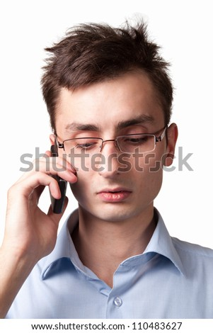 Young businessman talking on the mobile phone