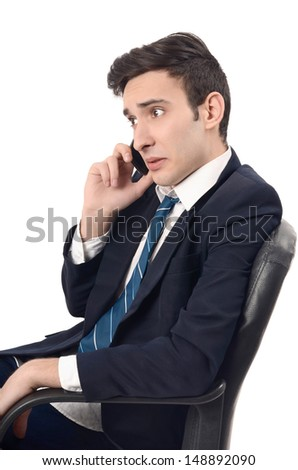 Young businessman talking on the phone. Shocking business phone conversation. Isolated on white background.