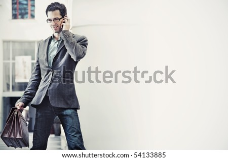 Young businessman talking over cellphone - stock photo