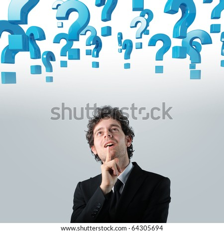 young businessman thinking and 3d question mark background - stock photo
