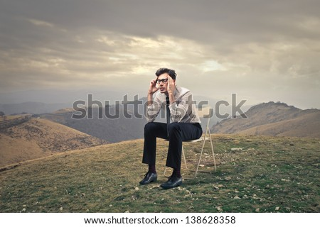 young businessman thinking intensely - stock photo