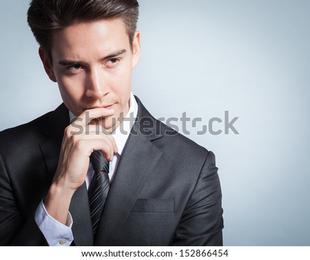 Young businessman thinking of idea - stock photo