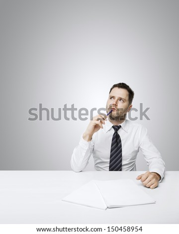 young businessman thinking sitting at table