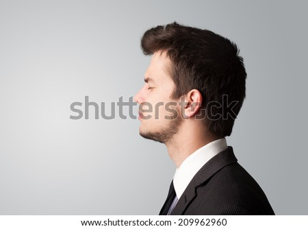Young businessman thinking with copyspace on color background - stock photo