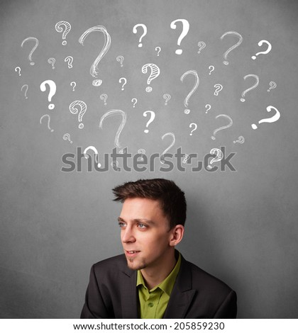 Young businessman thinking with sketched question marks all over his head - stock photo