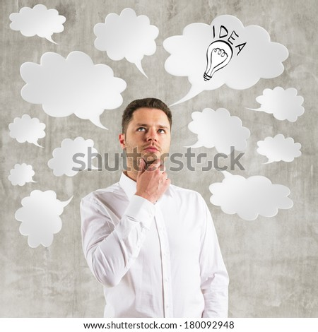 young businessman  thinking with speech bubble over head