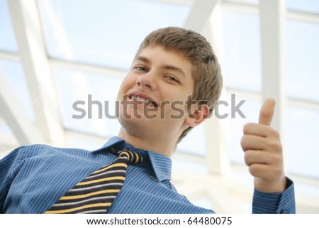 young businessman thumbs up