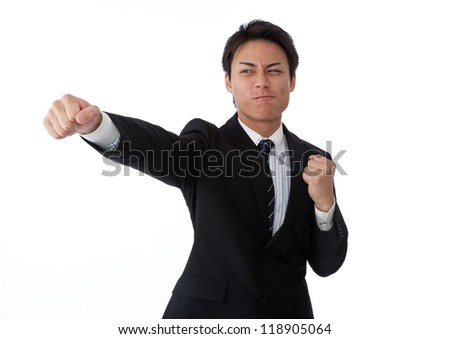 young businessman to hit the straight punch - stock photo
