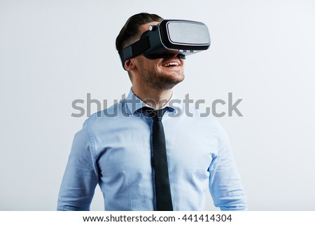 Young businessman trying vr goggles - stock photo
