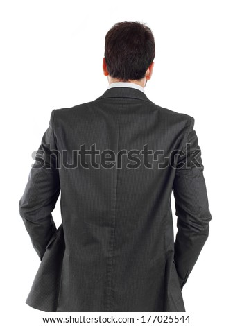 Young businessman turning his back to camera on white. - stock photo
