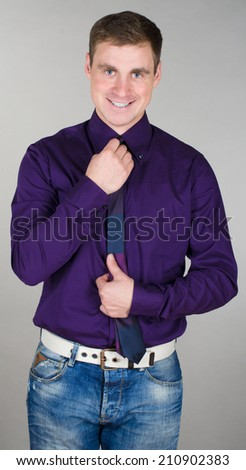 Young businessman tying his tie before stock photo 210902383 young businessman tying his tie before an important job interview ccuart Gallery