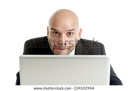 young businessman typing on computer keyboard with funny face expression on watching internet porn online or making money gambling on line isolated on white background - stock photo