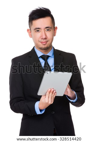 Young Businessman use of the tablet pc