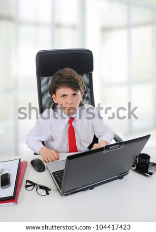 Young businessman using a laptop in the office.
