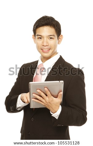 Young businessman using a tablet computer - stock photo