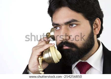 Young Businessman using a vintage telephone