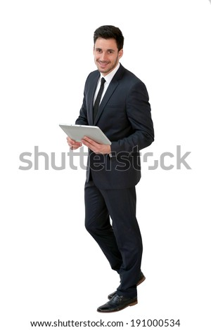Young businessman using digital tablet, isolated
