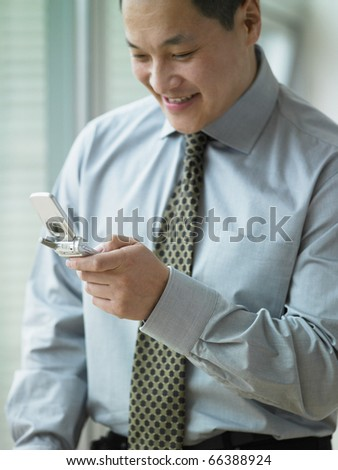 Young businessman using his cell phone - stock photo