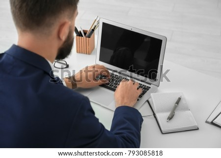 Young businessman using his laptop while working in office