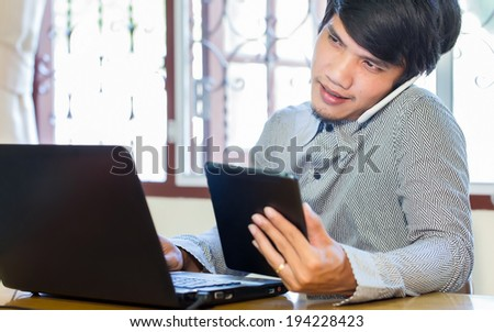 young businessman using his tablet