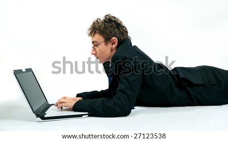 Young businessman using laptop in unusual position