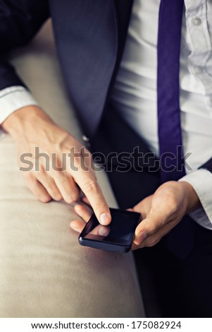 Young businessman using smart phone.