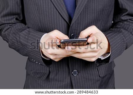 young businessman using smart phone on blackground