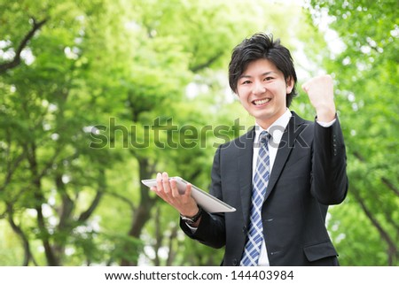 young businessman using tablet computer - stock photo