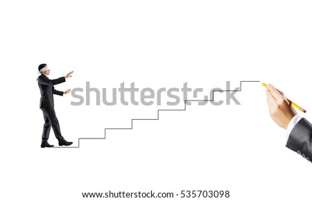 Young businessman walking forward on drawn twisted lines