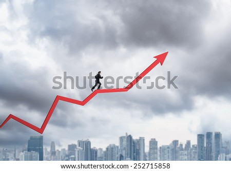 Young businessman walking on chart arrow going up - stock photo