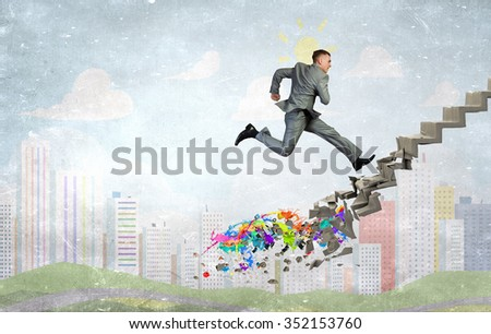 Young businessman walking up collapsing staircase representing success concept - stock photo
