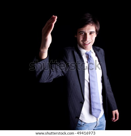 young businessman waving - stock photo