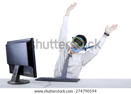 Young businessman wearing a snorkeling mask for celebrating his success in studio - stock photo