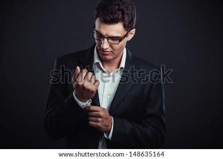 young businessman wearing glasses. Studio shoot. - stock photo