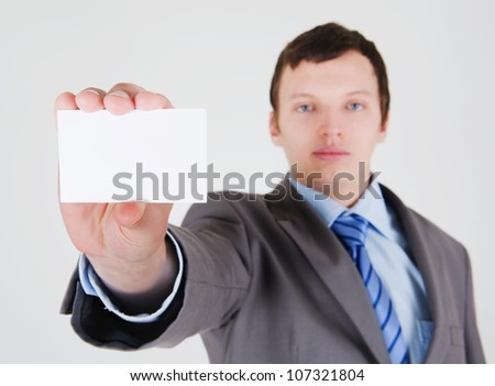 Young businessman with a blank business card - stock photo