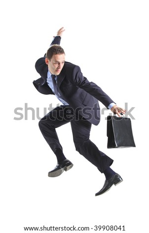Young businessman with a briefcase jumping against white background - stock photo