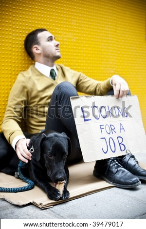 Young businessman with a dog holding sign Looking for a job
