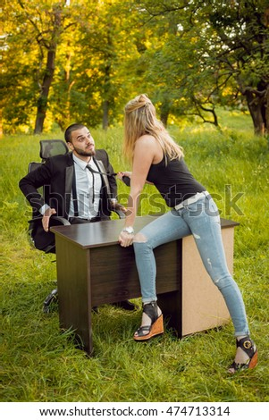 young businessman with a lady in park. beautiful background